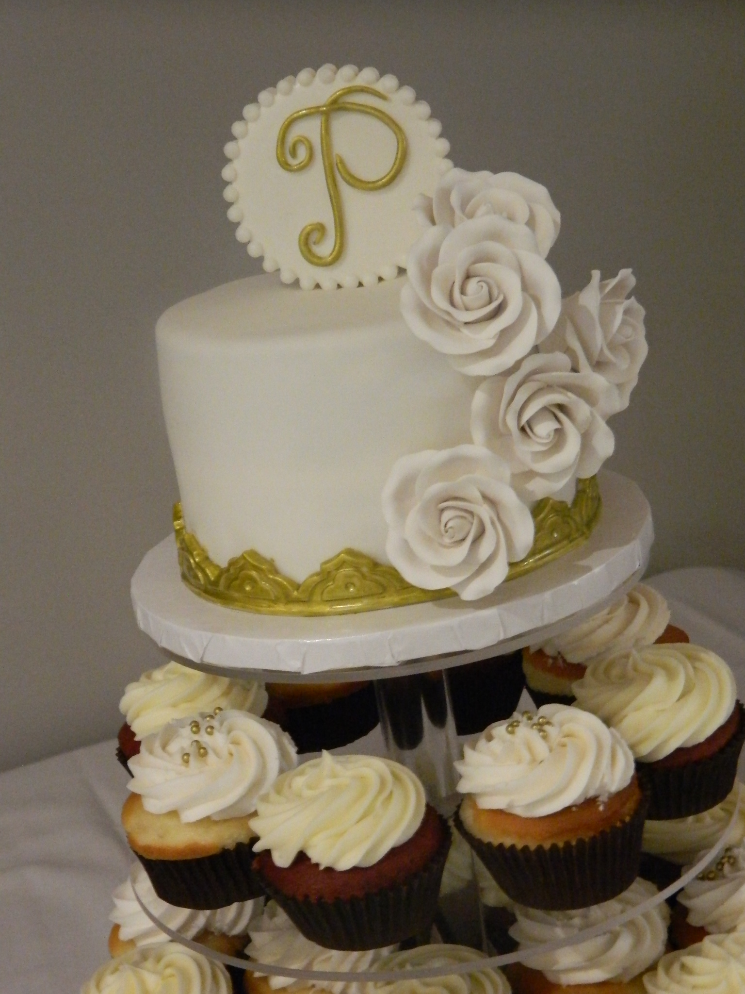 Gold wedding topper cake with cupcake tower