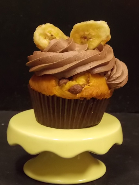 Chunky Monkey-Banana & chocolate chunk cupcake topped with milk chocolate buttercream and a couple of candied banana chips