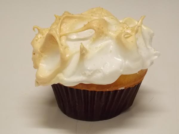 Vanilla cupcake with lemon curd filling and meringue topping