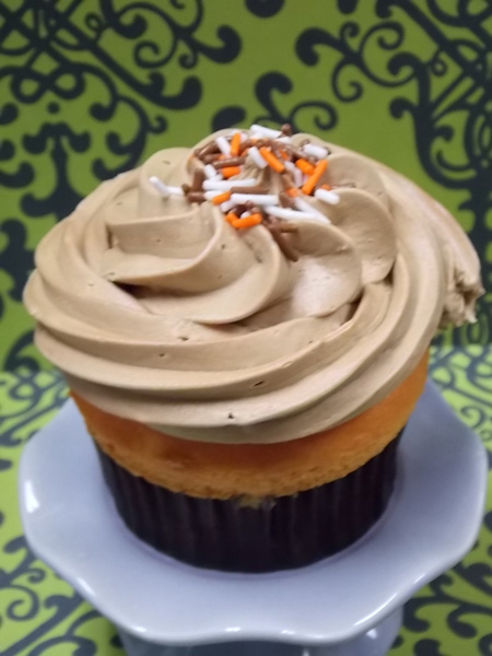 Catch a Tiger by it's Tail-Tangerine cupcake topped with Root Beer buttercream