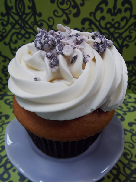 Blueberry Cheesecake-Blueberry cupcake filled with cream cheese & topped with our Madagascar vanilla buttercream