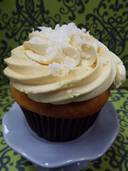 Pina Colada-Pineapple coconut cupcake with pineapple buttercream and a sprinkle of coconut on top