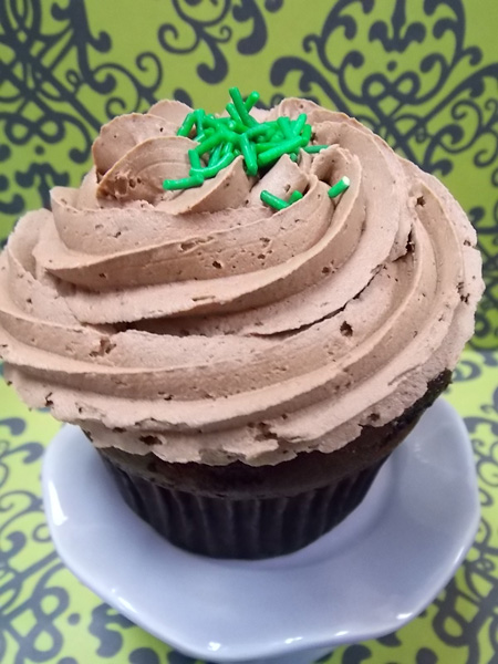 Peppermint Patty-Chocolate cupcake with a peppermint patty centre and topped with milk chocolate buttercream & sprinkles of mint