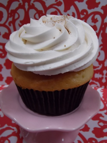 Eggnog-Eggnog cupcake a light rum buttercream and a sprinkle of nutmeg on top