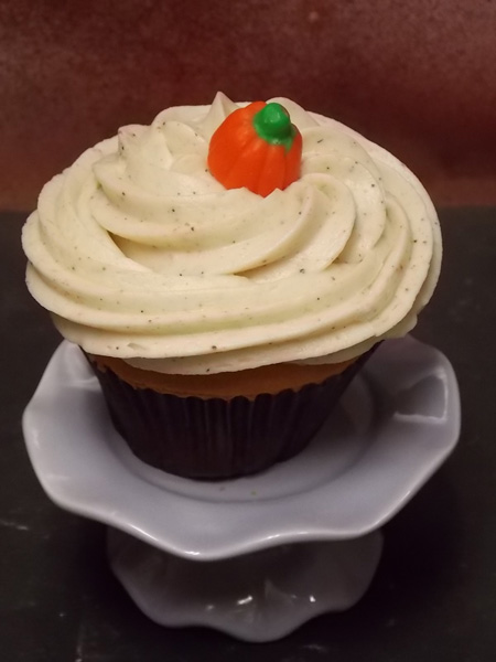 It's The Great Pumpkin-Festive pumpkin cupcake topped with a 'spiced' up cream cheese icing