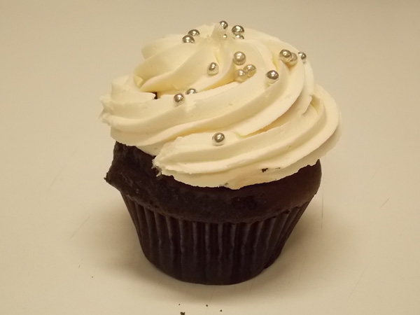 Chocolate fudge cupcake topped with madagascar vanilla buttercream