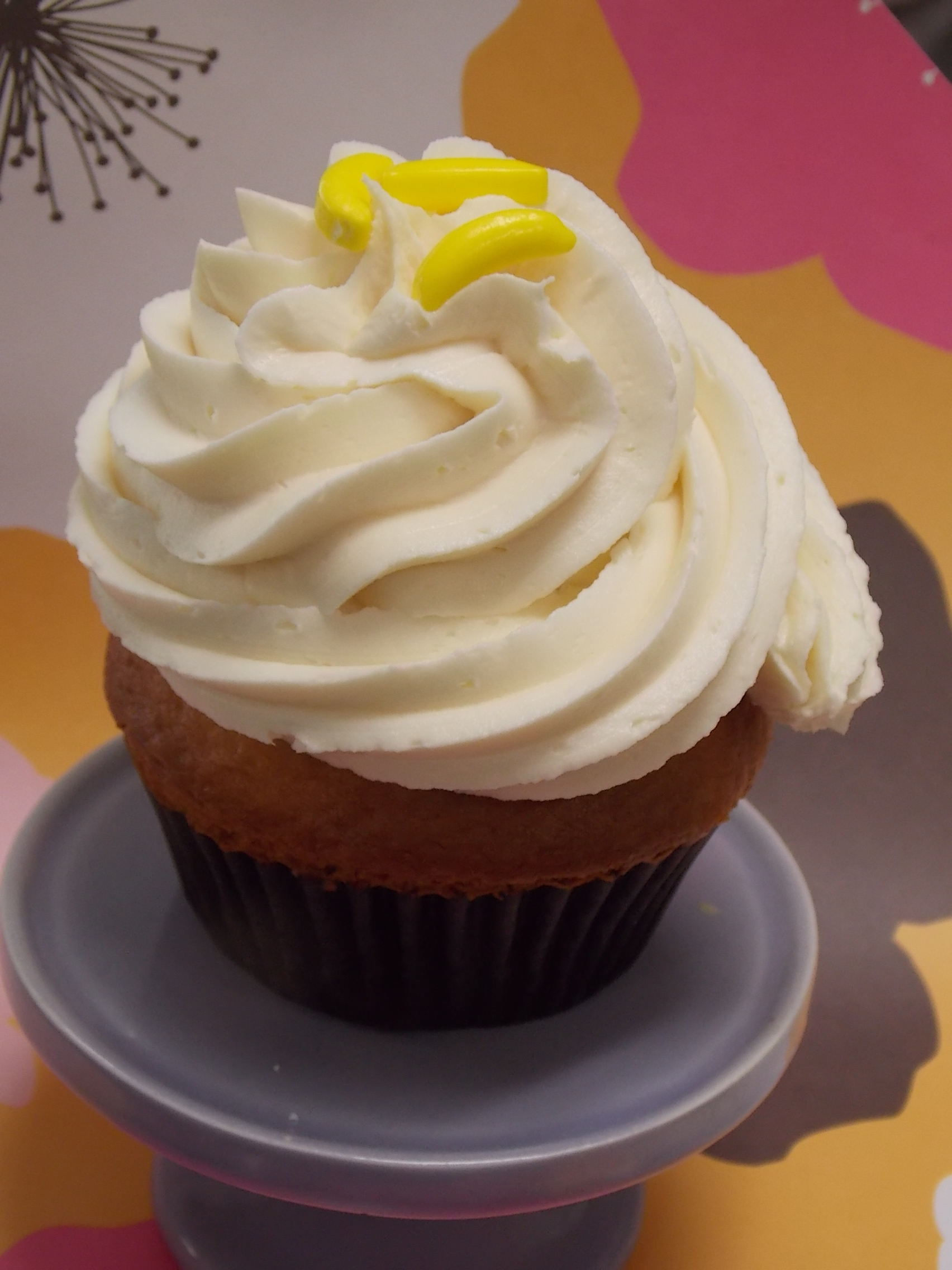 Mango Ban-ango-A Mango cupcake topped with a creamy banana buttercream and a few banana candies for the top