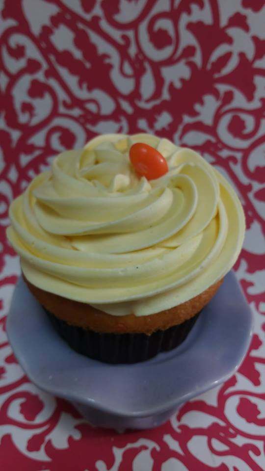 Tangerine Dreams-Tangerine cupcake with pineapple chunks baked in and topped with out sweet, creamy pineapple buttercream