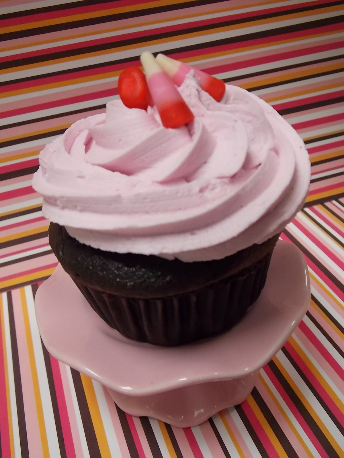 St. Valentine-A decadent chocolate cupcake with a ribbon of raspberry running through it and topped with our signature Raspberry buttercream