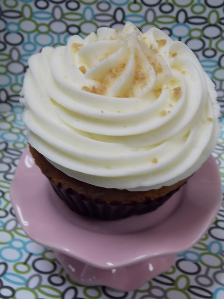 Hearty carrot cupcake with rich cream cheese icing